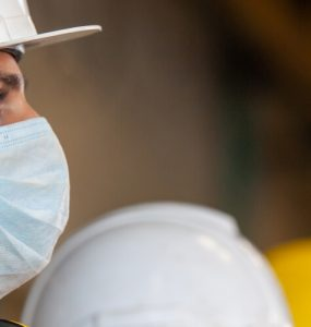 tradesperson on building site wearing coronavirus face mask